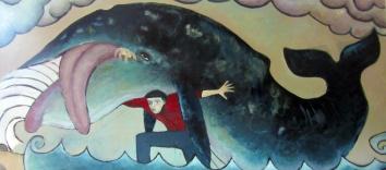 Hombre cargando una ballena